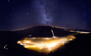Foggy Valley with Milky Way wallpaper