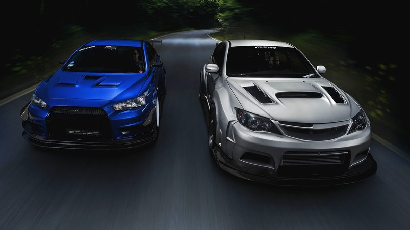 Mitsubishi Lancer Evolution and Subaru Impreza STi wallpaper
