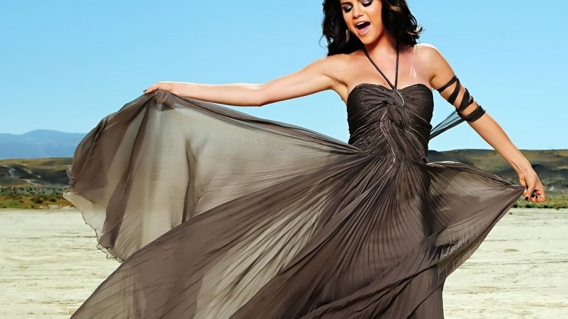 Selena Gomez Waving Dress wallpaper