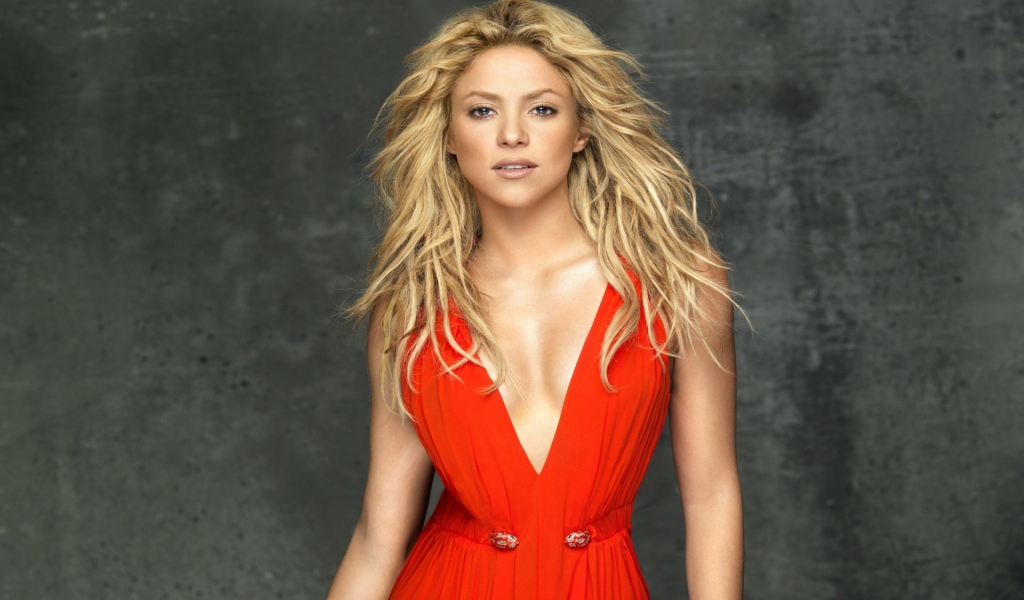 Shakira In Red Dress for 1024 x 600 widescreen resolution